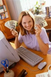 lady by pc with lots of money