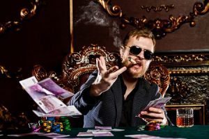 Mature man, smoking cigar and throwing money at poker table