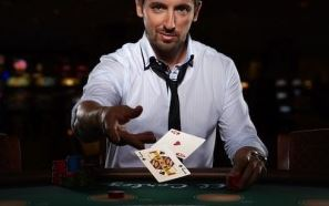 blackjackplayer throwing cards on table